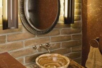 Assorted textures, cutting-edge design and natural colors give this small bathroom vanity sassy style.