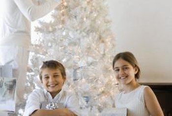 A white Christmas tree provides an ideal background for black-and-white decorations.