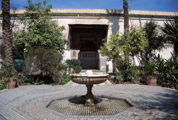 The water feature and textured tile create interest in this courtyard.