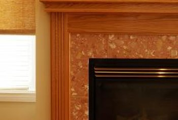 Glue trim to your fireplace.