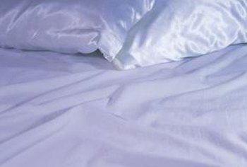 Wash satin pillowcases along with satin sheets for a compatible wash load.