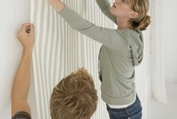 Apply sizing before hanging wallpaper.