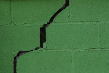 Structural problems cause cracks in brick walls.