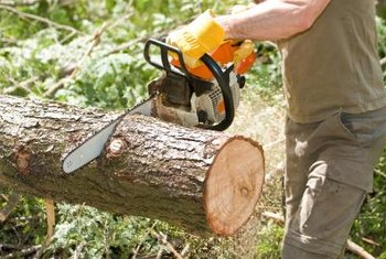 Maintain proper footing and balance when operating a chainsaw.