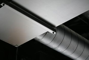 Fit the sides of half-circle cuts against round ducts.