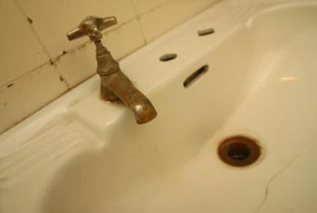 Rust stains on a sink are caused by the reaction of iron, water and oxygen.