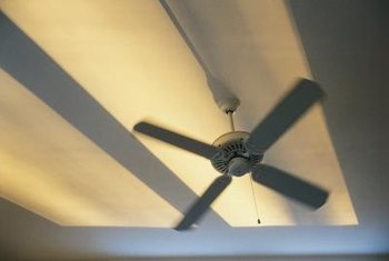Running fans in reverse pushes hot air down from the ceiling to the living space.