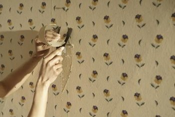 Apply adhesive with a paintbrush to fix peeling wallpaper.