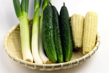 Cucurbits like cucumber and squash are warm season crops that thrive during summer months.