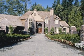 Driveway landscaping should lead guests safely to the front door.