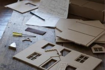 Square and rectangular cutouts in a dollhouse project make windows.