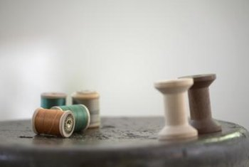 Craft charming Christmas decor from wooden thread spools.
