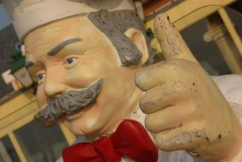 A chef statue adds a whimsical vibe to a themed kitchen.