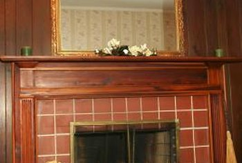 Installing tile over the brick on your fireplace can give it an entriely new look.