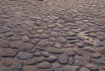 Cobblestones give a natural, rustic feel to an otherwise dull walkway.