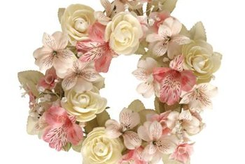 Arrange silk flowers to make a beautiful wreath for any holiday.
