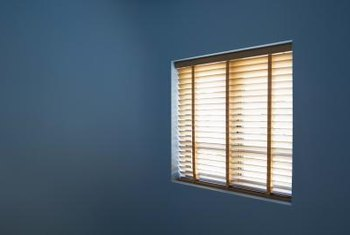 Draped fabric can dress up window blinds.