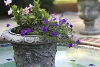 Flowers soften the urn material, adding a classic and formal look.