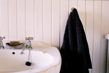 Consider both functionality and aesthetics when you're replacing bathroom walls.