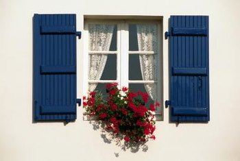 Potted geraniums on a windowsill give your home a European look.