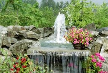 A large rock fountain simulates a waterfall in the home landscape.