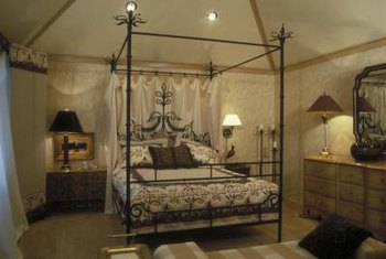 A canopy bed makes a dramatic centerpiece for a romantic castle style bedroom.