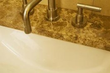 Mini widespread faucet handles connect to the spout under the countertop.