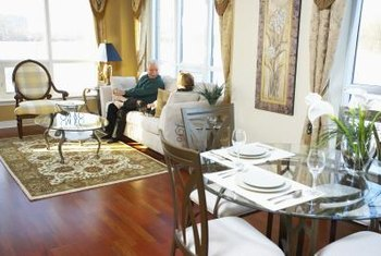 Furniture Arrangement In A Living Room Dining Combination The Carpet Separates Spaces And Matching Tables Link Them