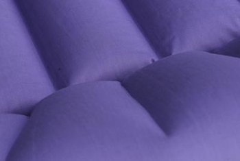 Rolling an air mattress, rather than only folding it, prevents creases.