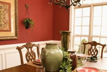 Red paint adds a bold punch of color in a dining room.