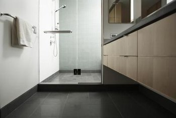 Dark bathroom floors create a dramatic look.