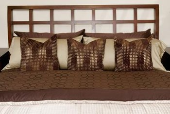 Accent pillows may used to punctuate a brown, black and gray bedroom.