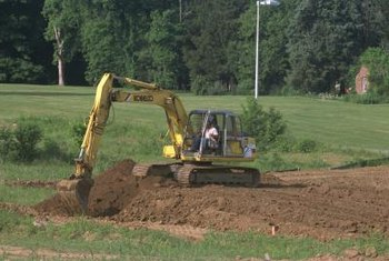 Perc tests involve digging holes to test the soil's water dissipation capacity.