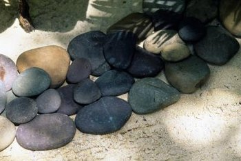 Pebbles of various colors add dimension and texture to your garden or yard.