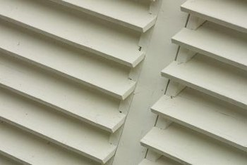 Spraying offers the best paint coverage for detailed shutters.