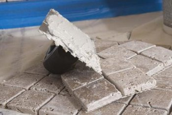 Seal tumbled tile and the grout lines after grouting to help keep out moisture.