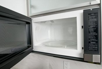 To save countertop space, microwaves are often mounted over the range.