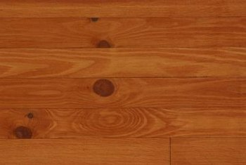 Oiling wood paneling after cleaning provides an inexpensive shine.