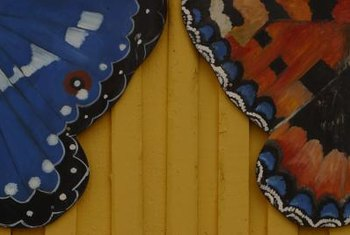 Mirror tropical butterflies by painting wood or plastic decorations in vivid color combinations.