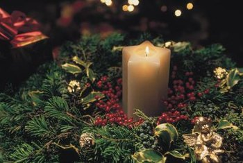 Winterberry combined with sprigs of evergreens, pinecones and a candle provides an inexpensive centerpiece.