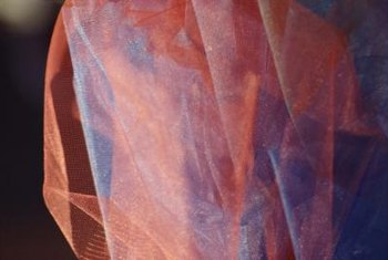 Layering colors in organza curtain panels creates visual interest.
