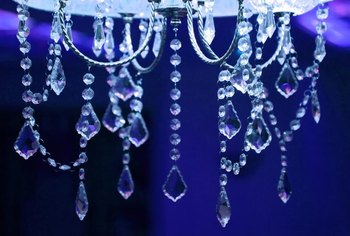 Sparkly silver, glass and crystal effects reflect light, brightening a dark-blue room.