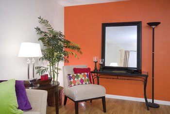 Create a focal point in an open plan by painting an accent wall in a bright color.