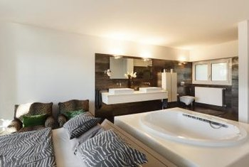 Modern interiors often fail to adequately separate the bedroom from the bathroom.