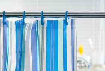 Instruction labels provide information about whether fabric curtains can withstand machine washing.