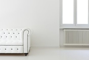 A plain vintage radiator blends into this all-white contemporary room.