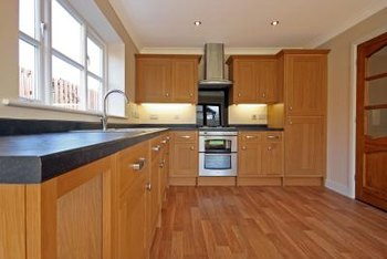 Medium brown flooring provides a soft contrast to beech cabinetry.