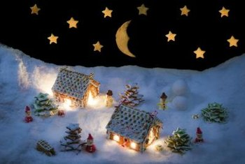 Lights enliven a Christmas village display and gold foil stars in the night sky add a touch of fantasy.