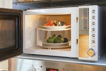Install the microwave inside a cupboard or on a special shelf attached to the cupboard above.
