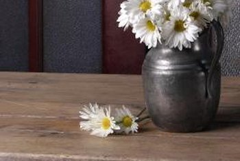 Old vases and new flowers are both simple country decorating accents.